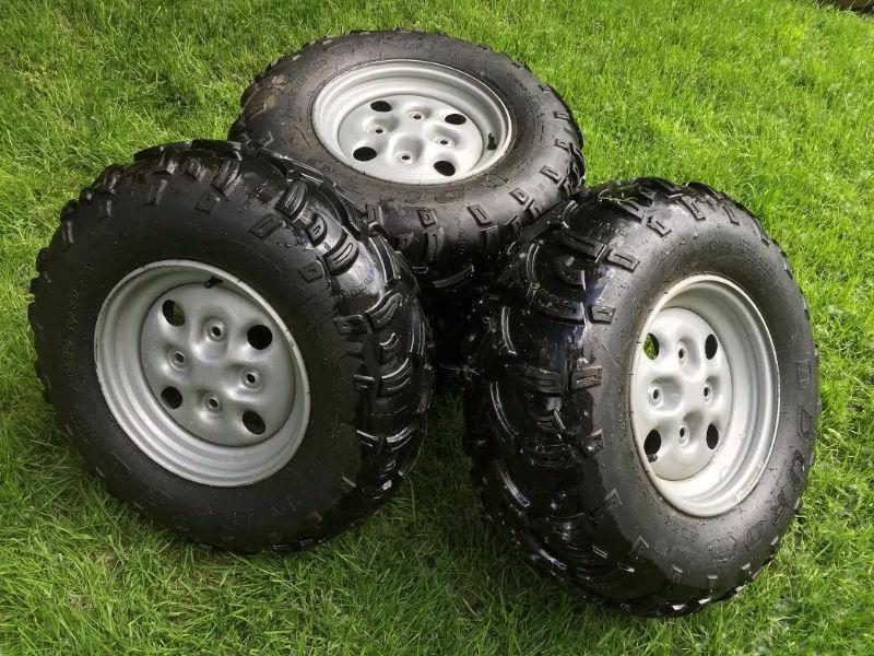 ATV TIRES & RIMS OFF AN ARTIC CAT