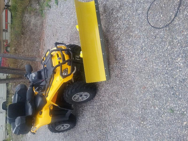 Quad with blade and chains for sale
