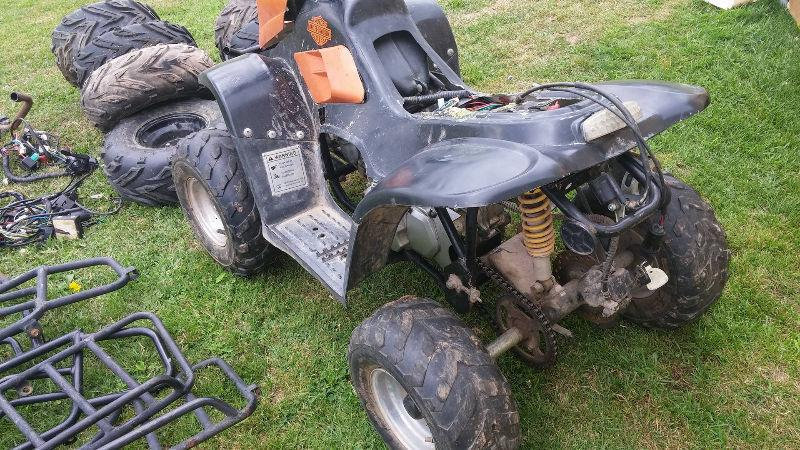 gio atv at with alot of parts